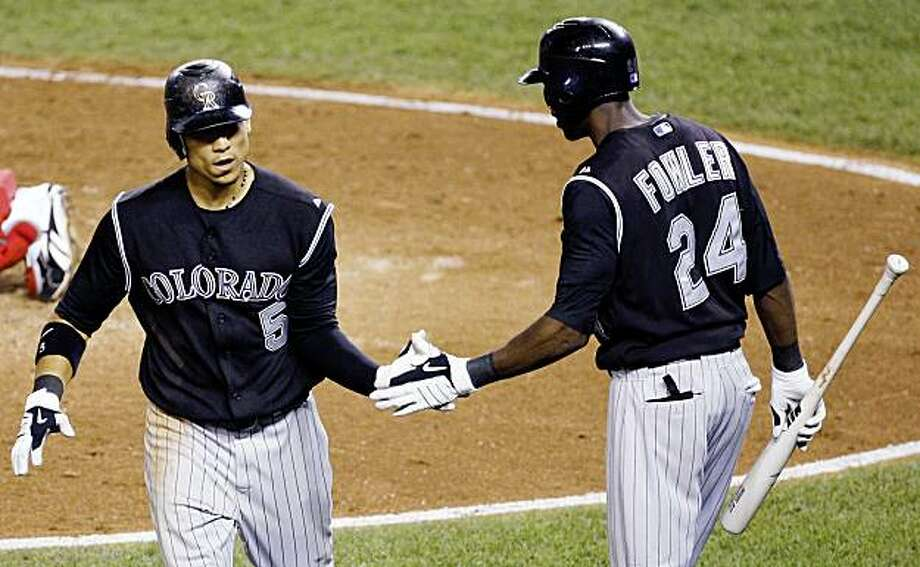 Colorado Rockies' Carlos Gonzalez, left, is congratulated by teammate Dexter Fowler after hitting a solo home run on a line drive to right field during the eighth inning of a baseball game Tuesday, Aug. 18, 2009, in Washington. The Rockies won 4-3. (AP Photo/Haraz N. Ghanbari) Photo: Haraz N. Ghanbari, AP