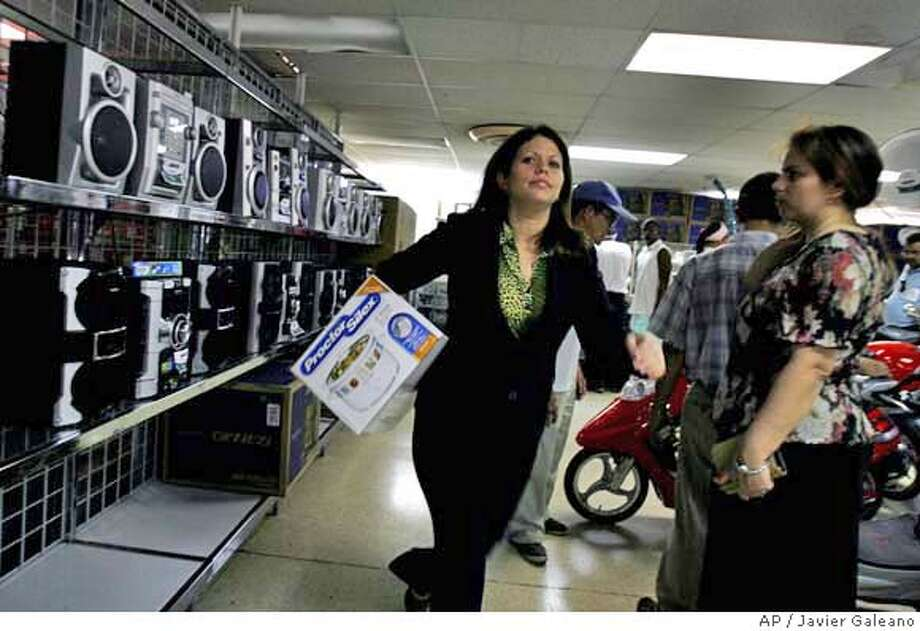 ###Live Caption:A woman leaves after buying a pressure cooker in a store in Havana, Tuesday, April 1, 2008. Cuban shoppers are buying goods for the first time that were previously available only to foreigners after the government of new President Raul Castro lifted a ban on products that affected Cuban citizens. (AP Photo/Javier Galeano)###Caption History:A woman leaves after buying a pressure cooker in a store in Havana, Tuesday, April 1, 2008. Cuban shoppers are buying goods for the first time that were previously available only to foreigners after the government of new President Raul Castro lifted a ban on products that affected Cuban citizens. (AP Photo/Javier Galeano)###Notes:###Special Instructions:EFE OUT Photo: Javier Galeano
