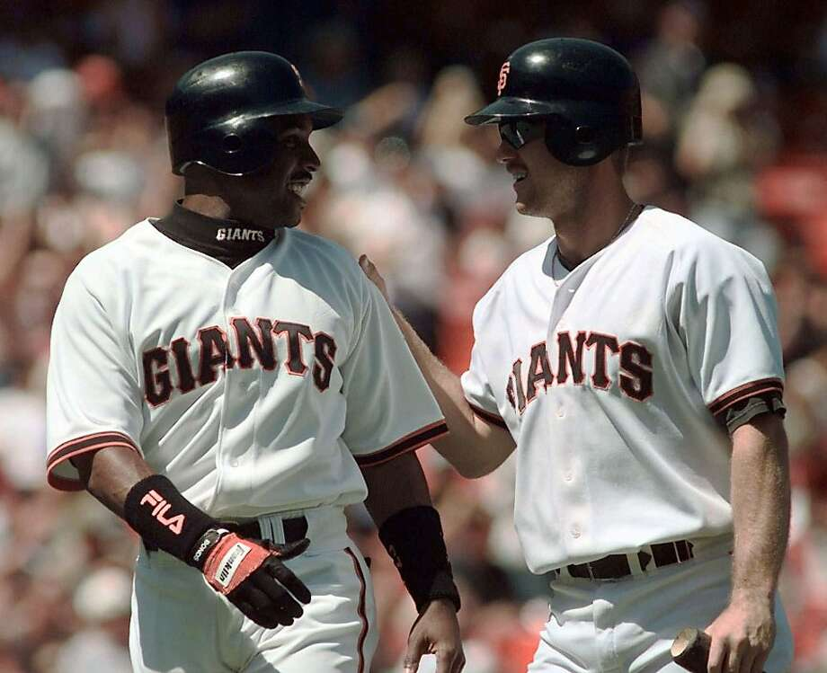 San Francisco Giants' Barry Bonds, left, and Jeff Kent greet each other at home plate after scoring the Giants third and fourth runs against the Montreal Expos during the first inning of their game in San Francisco, Wednesday, Sept. 2, 1998. Bonds had four rbis, homered, and went three for three and Kent added two doubles and four rbi's in the Giants, 12-3, win over the Expos. Photo: Eric Risberg, AP