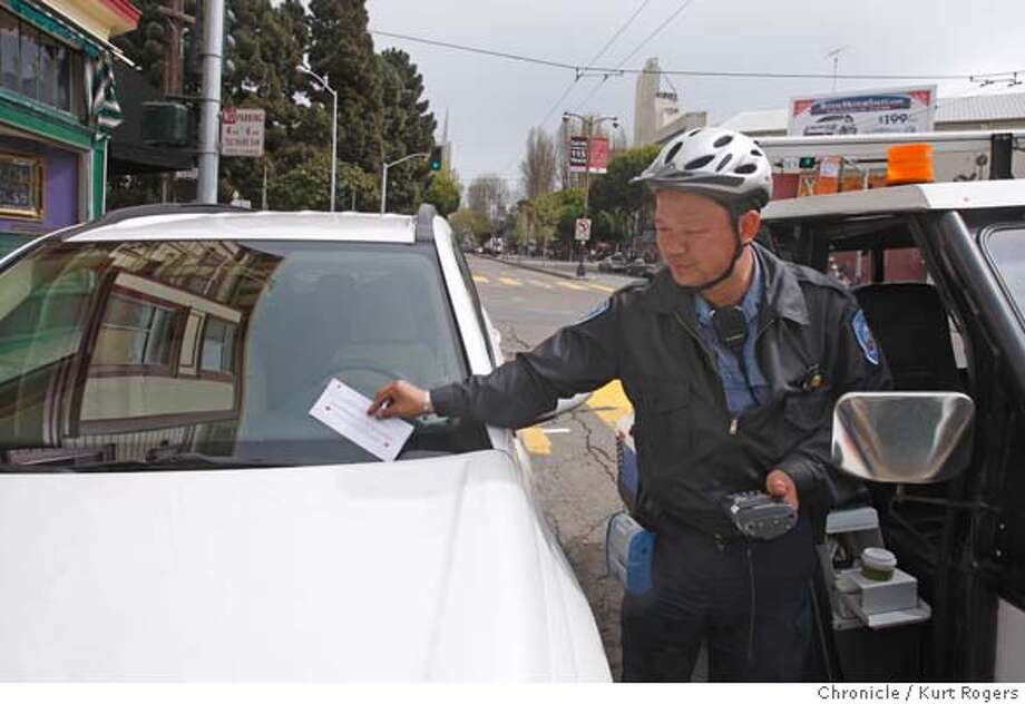 ###Live Caption:An unidentified San Francisco Parking Control Officer issues a parking ticket on Columbus Ave in San Francisco, Calif. on Friday March 28, 2008. Parking fines will rise as part of the city's effort to mitigate its budget crisis. Photo By Kurt Rogers / San Francisco Chronicle###Caption History:A Parking Officer gives out tickets on Clumbus Ave in San Francisco. Fines for tickets will rise as part of the city�s effort to mitigate its budget crisis. On Friday March 28 2008 in San Francisco, Calif  Photo By Kurt Rogers / San Francisco Chronicle Ran on: 04-02-2008  Caught! An officer writes a ticket on Columbus Avenue in San Francisco, where the cost of illegal parking is about to rise.###Notes:Parking tickets.###Special Instructions:MANDATORY CREDIT FOR PHOTOG AND SAN FRANCISCO CHRONICLE/NO SALES-MAGS OUT Photo: Kurt Rogers