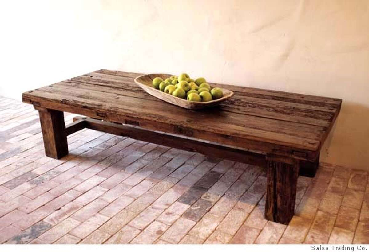 ###Live Caption:table from Salsa Trading Co., Sonoma; with vintage doors over 100 years old, but the body is made with reclaimed wood, $1,300###Caption History:table from Salsa Trading Co., Sonoma###Notes:###Special Instructions: