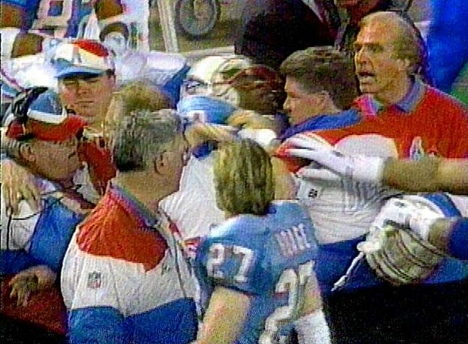 Houston Oilers players and coaches seperate defensive coordinator Buddy Ryan, left with headset after he threw a punch at Oilers' offensive coordinator Kevin Gilbride, right with back toward camera, during a sideline confrontation shortly before halftime against the New York Jets Sunday, Jan. 2, 1994, in Houston, in this image from television. Photo: AP
