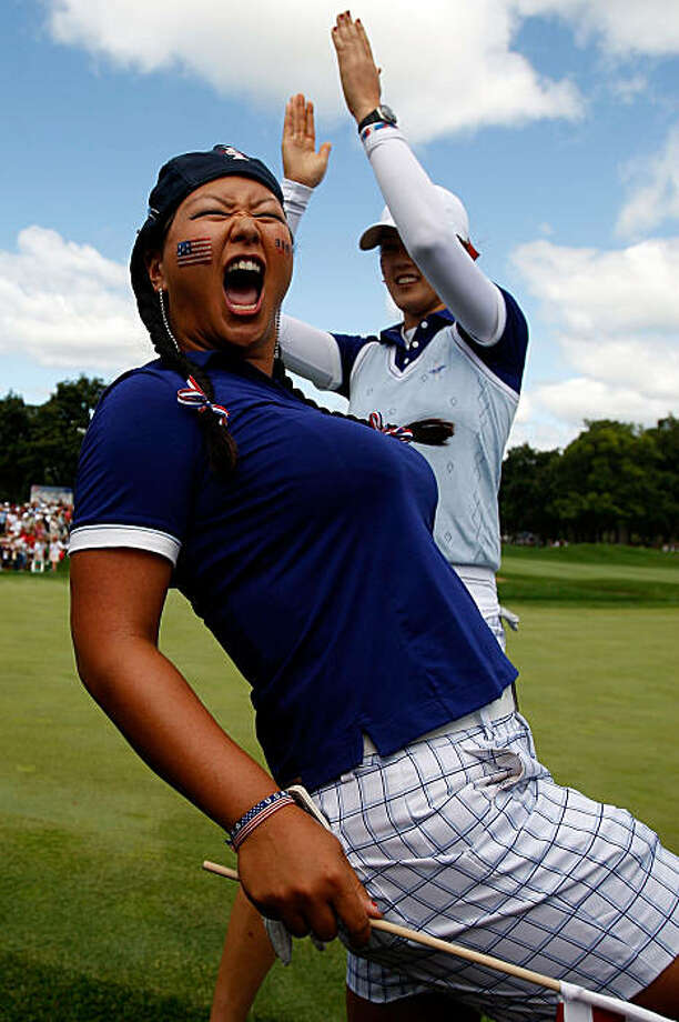 SUGAR GROVE, IL - AUGUST 22:  Christina Kim left, and Michelle Wie of the U.S. Team celebrate after defeating Helen Alfredsson and Tania Elosegui of the European Team during the Saturday morning Fourball matches at the 2009 Solheim Cup at Rich Harvest Farms on August 22, 2009 in Sugar Grove, Illinois.  (Photo by Chris Graythen/Getty Images) Photo: Chris Graythen, Getty Images