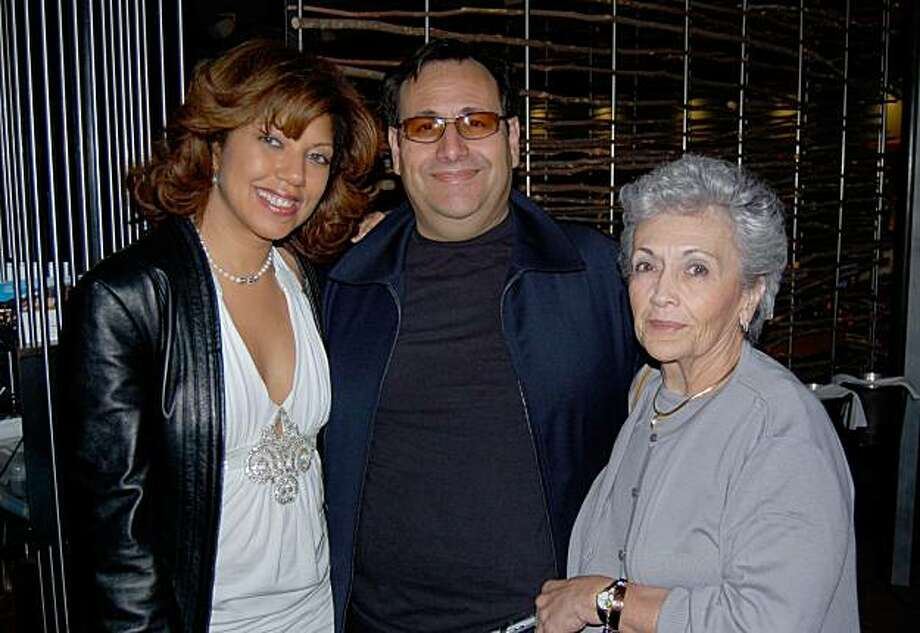 This Nov. 4, 2006 photo provided by Sunda Croonquist shows, from left, Croonquist, husband Mark Zafrin and mother-in-law Ruth Zafrin at Boa's Steakhouse in the Hollywood area of Los Angeles. Veteran comic Croonquist is being sued by her mother-in-law after making her the punchline of too many jokes. (AP Photo/Courtesy of Sunda Croonquist, ho) Photo: AP