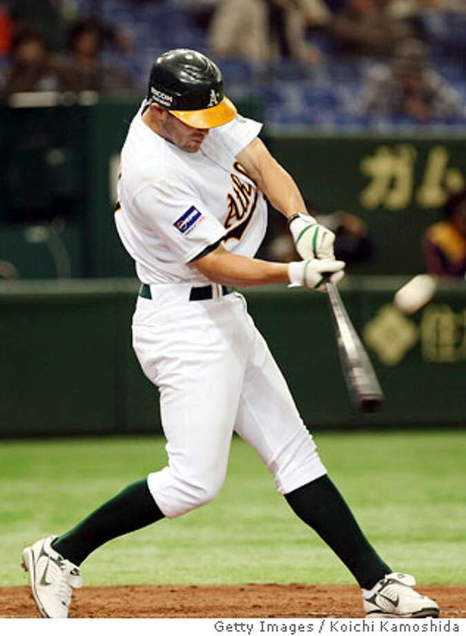 TOKYO - MARCH 23: Infielder Bobby Crosby #7 of the Oakland Athletics hits during a preseason friendly between the Oakland Athletics and the Hanshin Tigers at Tokyo Dome March 23, 2008 in Tokyo, Japan. (Photo by Koichi Kamoshida/Getty Images)  Ran on: 04-01-2008  A's shortstop Bobby Crosby believes facing the same pitchers who worked in last week's games at the Tokyo Dome will favor the hitters.  Ran on: 04-01-2008 Photo: Koichi Kamoshida