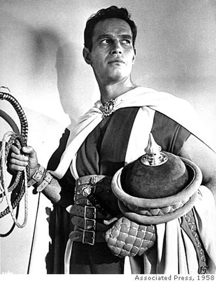 "** FILE **Actor Charlton Heston poses in character, in the title role of the motion picture ""Ben-Hur,"" on April 29, 1958, at Cinecitta studios in Rome, Italy. Heston, who won the 1959 best actor Oscar as the chariot-racing ""Ben-Hur"" and portrayed Moses, Michelangelo, El Cid and other heroic figures in movie epics of the '50s and '60s, died Saturday April 5, 2008 according to a statement from the actor's family. He was 86. (AP Photo)"