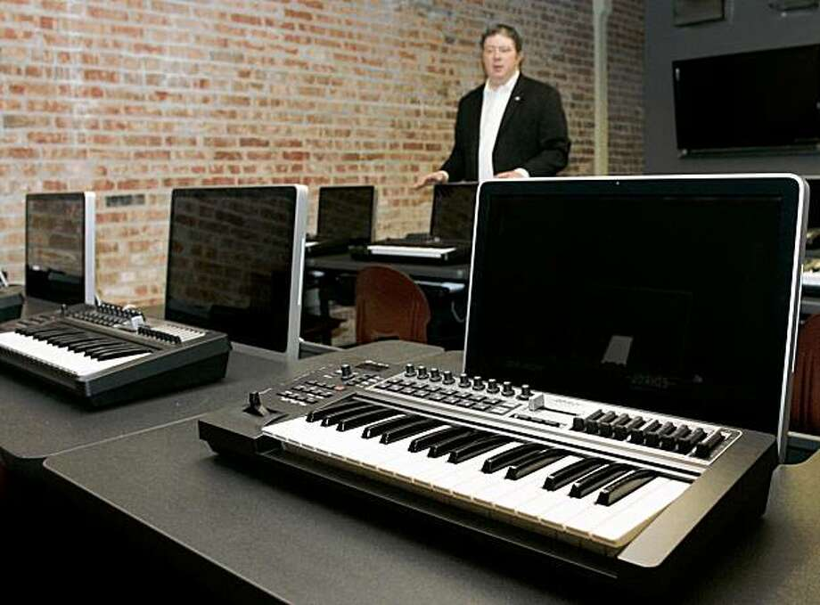 In this photo taken, Thursday, Aug. 6, 2009, director Scott Booker is pictured with production computers in a classroom at the Oklahoma City campus of the Academy of Contemporary Music in Oklahoma City. Photo: AP
