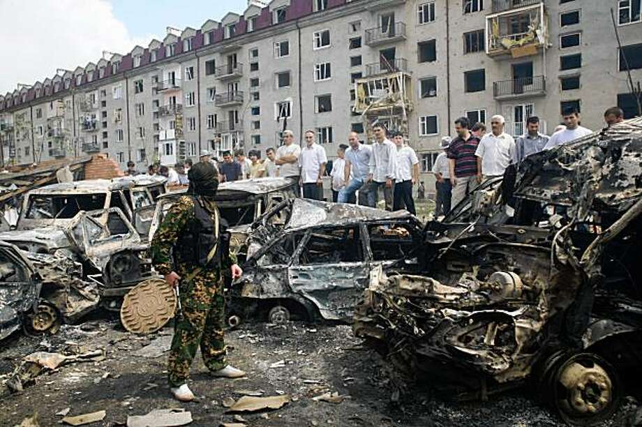 Destroyed cars are seen at a police station in Nazran, Ingushetia, Russia, Monday, Aug. 17, 2009. A suicide bomber exploded a truck at a police station in Russia's restive North Caucasus Monday, killing at least 20 people and wounding 60 others, officials said. Photo: Musa Sadulayev, AP