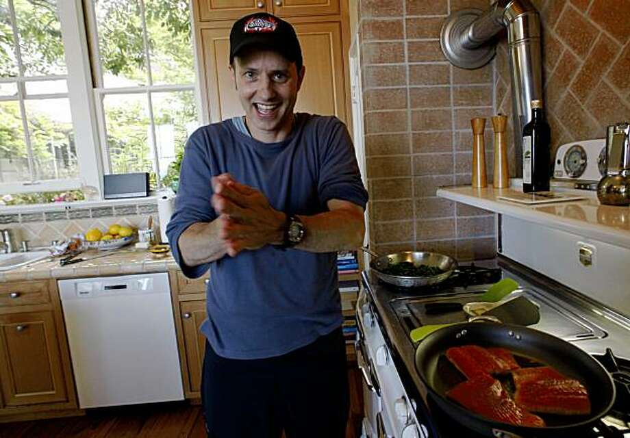 Olympic figure skater Brian Boitano making salmon at home in San Francisco, Calif., on Tuesday, July 28, 2009. Photo: Liz Hafalia, The Chronicle