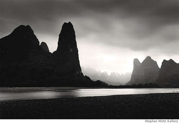 """Lijiang River, Study 6, Guilin, China"" (2006)  sepia toned silver gelatin print by Michael Kenna Ran on: 04-05-2008  &quo;Outer Staircase, Mont St. Michel, France&quo; (2004), sepia-toned silver gelatin print, top, and &quo;Lijiang River, Study 6, Guilin, China&quo; (2006), above, sepia-toned silver gelatin print, by Michael Kenna. Photo: Kenneth Baker"
