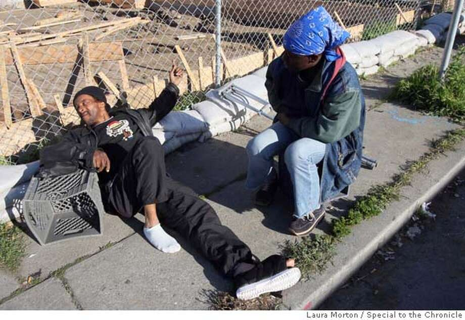 "###Live Caption:Willie ""Rabbit"" Jasper (left) lays on the street to rest his wounded foot in Richmond, Calif., on Sunday, March 30, 2008. Jasper was shot, along with four others, on Sunday morning outside the Church of the Living God on Florida Ave. in Richmond, Calif. Photo by Laura Morton / Special to The Chronicle###Caption History:Willie ""Rabbit"" Jasper (left) lays on the street to rest his wounded foot in Richmond, Calif., on Sunday, March 30, 2008. Jasper was shot, along with four others, on Sunday morning outside the Church of the Living God on Florida Ave. in Richmond, Calif. Photo by Laura Morton / Special to The Chronicle###Notes:Willie ""Rabbit"" Japser###Special Instructions: Photo: Laura Morton"