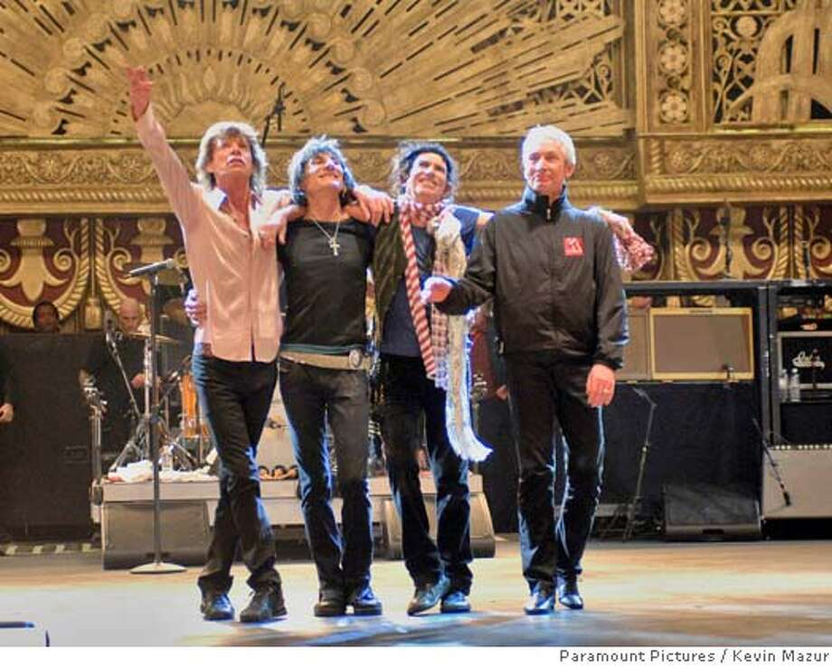 "This undated photo provided by Paramount Pictures shows Mick Jagger, left, Ronnie Wood, second from left, Keith Richards, second from right, and Charlie Watts during a scene from ""Shine A Light."" (AP Photo/Paramount Pictures) Photo: Kevin Mazur"