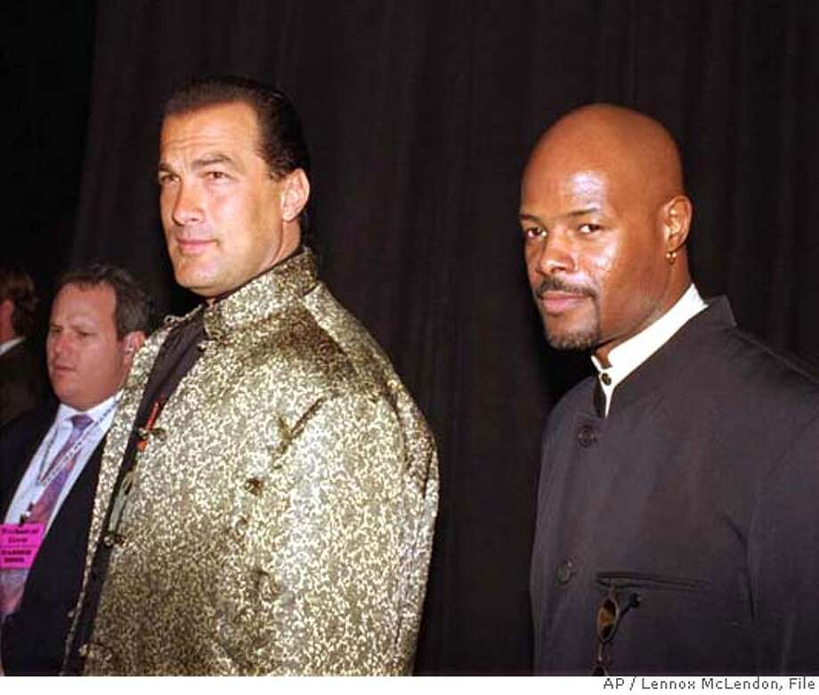 "###Live Caption:Actors Keenen Ivory Wayans, right, and Steven Seagal arrive at the Warner Bros. luncheon during the National Association of Theater Owners convention Wednesday, March 6, 1996, in Las Vegas. The two star in Warner Bros. new action-thriller movie, ""The Glimmer Man,"" later this year. (AP Photo/Lennox McLendon)###Caption History:Actors Keenen Ivory Wayans, right, and Steven Seagal arrive at the Warner Bros. luncheon during the National Association of Theater Owners convention Wednesday, March 6, 1996, in Las Vegas. The two star in Warner Bros. new action-thriller movie, ""The Glimmer Man,"" later this year. (AP Photo/Lennox McLendon)###Notes:###Special Instructions: Photo: LENNOX MCLENDON"