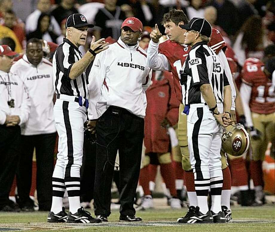 SAN FRANCISCO - AUGUST 22:  San Francisco Head Coach Mike Singletary and San Francisco 49ers quarterback Shaun Hill #13 talk to officials during the 4th quarter as the San Francisco 49ers host the Oakland Raiders at Candlestick Park August 22, 2009 in San Francisco, California.  (Photo by David Paul Morris/Getty Images) Photo: David Paul Morris, Getty Images