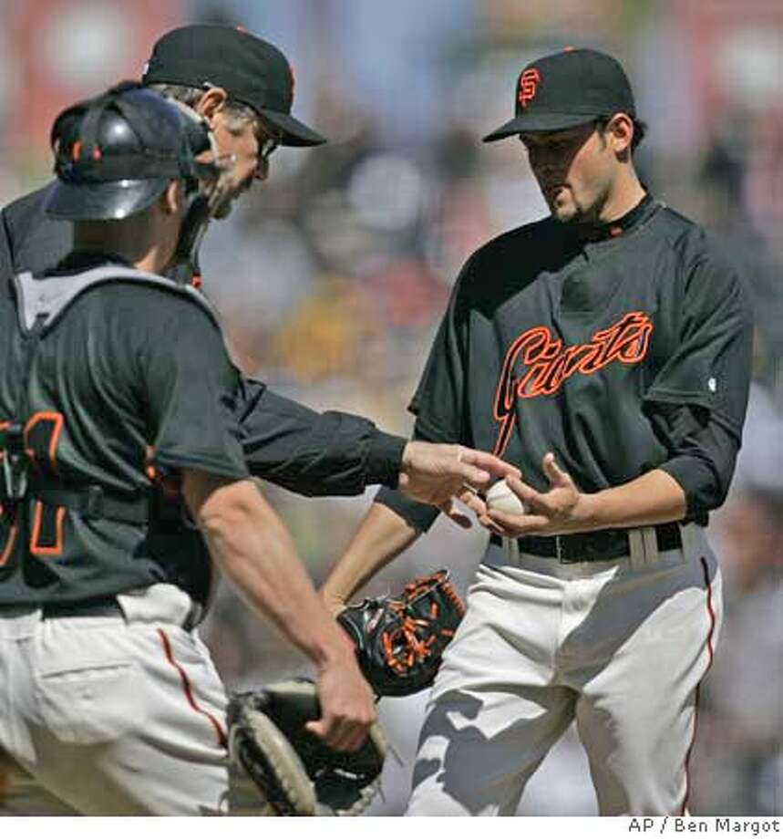 ###Live Caption:San Francisco Giants' Jonathan Sanchez, right, gives up the ball to manager Bruce Bochy, second from left, as catcher Steve Holm looks on in the seventh inning of an exhibition baseball game against the Oakland Athletics, Sunday, March 30, 2008, in San Francisco. The A's won the game, 7-2. (AP Photo/Ben Margot)###Caption History:San Francisco Giants' Jonathan Sanchez, right, gives up the ball to manager Bruce Bochy, second from left, as catcher Steve Holm looks on in the seventh inning of an exhibition baseball game against the Oakland Athletics, Sunday, March 30, 2008, in San Francisco. The A's won the game, 7-2. (AP Photo/Ben Margot)###Notes:Jonathan Sanchez, Bruce Bochy, Steve Holm###Special Instructions:EFE OUT Photo: Ben Margot