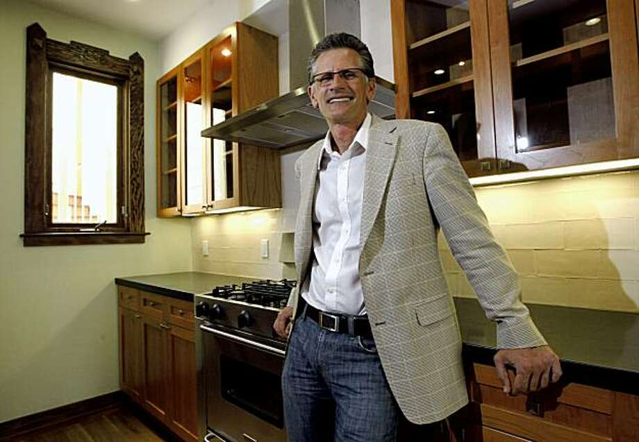 San Francisco Architect Mark English stands in the upscale kitchen of one of the rental units at #5 Alma Street in San Francisco. Aug 6, 2009. The owner elected to offer high-end equipment like polished granite, and upscale appliances similar to their unit. Photo: Lance Iversen, The Chronicle