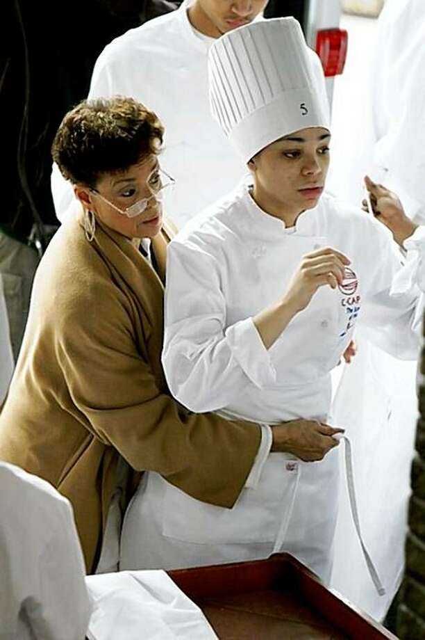 "Culinary arts teacher Wilma Stephenson and student Erica Gaither in ""Pressure Cooker."" Photo: Bev Pictures"