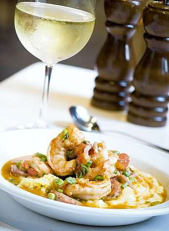From Slightly North of Broad, this is Chef Frank Lee's award winning Maverick Shrimp & Grits.  He received a GQ Golden Dish Award for this years ago and it's always on the menu: Maverick Shrimp & Grits  - local yellow grits with shrimp, house-made sausage & country ham, tomatoes, green onions, spice  $16.50 Photo: Maverick Southern Kitchens