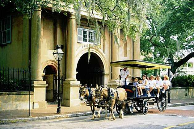 visitors on a carriage ride in Charleston, S.C. Photo: Charleston Area Conv & Visitors Bureau, AP
