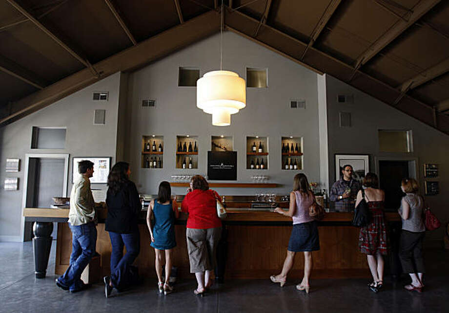 Visitors sample a variety of wines from several vintners at the Grange Sonoma tasting room in Sonoma, Calif., on Saturday, July 18, 2009. Photo: Paul Chinn, The Chronicle