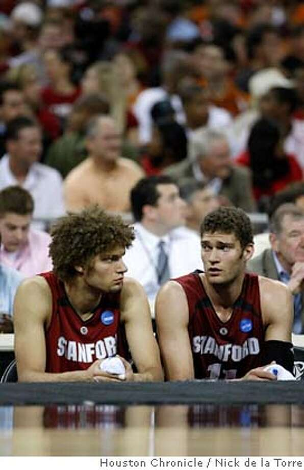 ###Live Caption:Stanford center Robin Lopez, left and his brother Brook Lopez sit in sadnessthe final minutes of their game against Texas half of his NCAA South Regional game Friday, March 28, 2008, in Reliant Stadium in Houston. Texas won 82-62. ( Nick de la Torre / Houston Chronicle )###Caption History:Stanford center Robin Lopez, left and his brother Brook Lopez sit in sadnessthe final minutes of their game against Texas half of his NCAA South Regional game Friday, March 28, 2008, in Reliant Stadium in Houston. Texas won 82-62. ( Nick de la Torre / Houston Chronicle )###Notes:NOTE THIS IS A HOUSTON CHRONICLE PHOTOG###Special Instructions:MANDATORY CREDIT  contact de la Torre cell 713.817.7335 Photo: Nick De La Torre