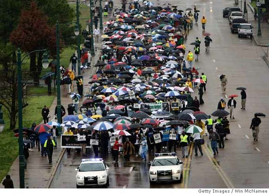 """###Live Caption:MEMPHIS, TN - APRIL 04: Members of the Memphis group """"Beloved Community"""" take part in a march to the Lorraine Hotel, the site where Martin Luther King Jr. was killed, as part of the opening event marking the slain civil rights leader's death April 4, 2008 in Memphis, Tennessee. King was killed by James Earl Ray 40 years ago today. (Photo by Win McNamee/Getty Images)###Caption History:MEMPHIS, TN - APRIL 04: Members of the Memphis group """"Beloved Community"""" take part in a march to the Lorraine Hotel, the site where Martin Luther King Jr. was killed, as part of the opening event marking the slain civil rights leader's death April 4, 2008 in Memphis, Tennessee. King was killed by James Earl Ray 40 years ago today. (Photo by Win McNamee/Getty Images)###Notes:40th Anniversary Of MLK's Assassination Remembered###Special Instructions: Photo: Win McNamee"""