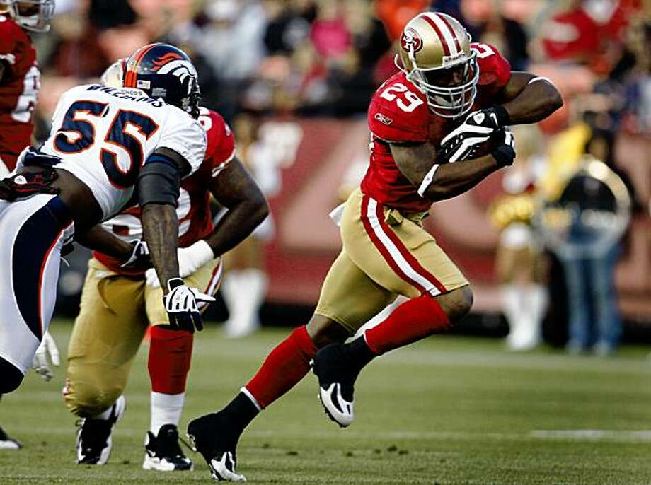 Glen Coffee runs for a 15-yard gain in the first quarter of the San Francisco 49ers vs. Denver Broncos pre-season football game at Candlestick Park in San Francisco, Calif., on Friday, Aug. 14, 2009. Photo: Paul Chinn, The Chronicle