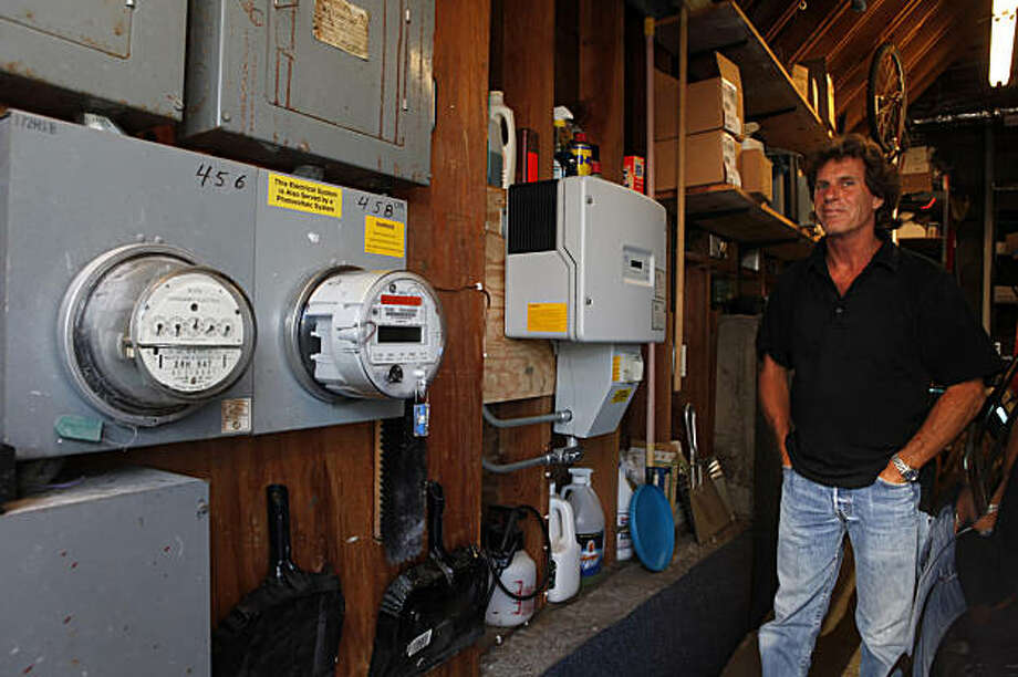 Electrical contractor Peter Dobbs considers solar panels to be just another upgrade, like the new kitchen, windows and floors he installed in his San Francisco, Calif., home. He is seen here with the solar systems power unit in his garage. When it came time for him to install them, he bought the system outright and got a $6,000 rebate from the city for it. Photo: Carlos Avila Gonzalez, The Chronicle
