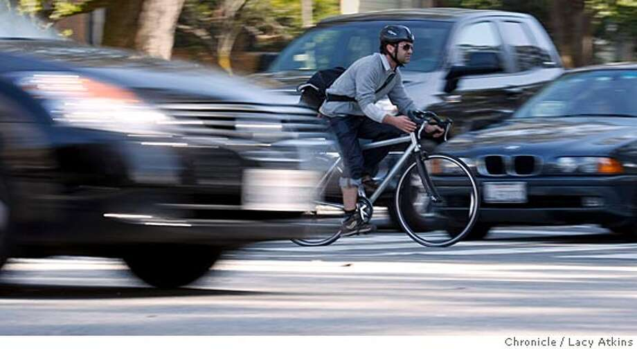 A bicyclists rides through the traffic down Fell Street to cross the intersection of Masonic, Wednesday April 3, 2008, in San Francisco, Calif. THis intersection is known as one of the most dangerous to bikers. Photo by Lacy Atkins / San Francisco Chronicle  Ran on: 04-04-2008  A bicyclist rides down Fell Street through traffic to cross the intersection at Masonic Avenue. Photo: Lacy Atkins