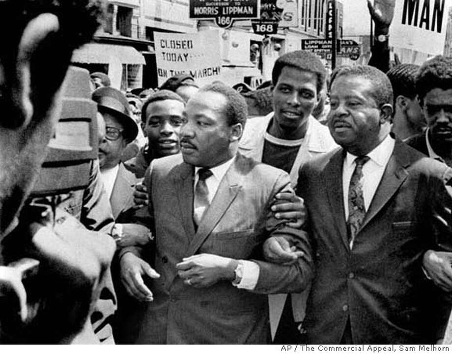 ###Live Caption:Dr. Martin Luther King Jr. and Rev. Ralph Abernathy, right, lead a march on behalf of striking Memphis sanitation workers March 28, 1968. The dignity of the march soon gave way to disorder as a group of about 200 youths began breaking windows and looting. King agonized over what had happened. Within a week, King was dead, killed by an assassin's bullet at Memphis' Lorraine Motel. (AP Photo/Sam Melhorn, The Commercial Appeal)###Caption History:Dr. Martin Luther King Jr. and Rev. Ralph Abernathy, right, lead a march on behalf of striking Memphis sanitation workers March 28, 1968. The dignity of the march soon gave way to disorder as a group of about 200 youths began breaking windows and looting. King agonized over what had happened. Within a week, King was dead, killed by an assassin's bullet at Memphis' Lorraine Motel. (AP Photo/Sam Melhorn, The Commercial Appeal)###Notes:###Special Instructions: Photo: Memphis Commercial Appeal 1968