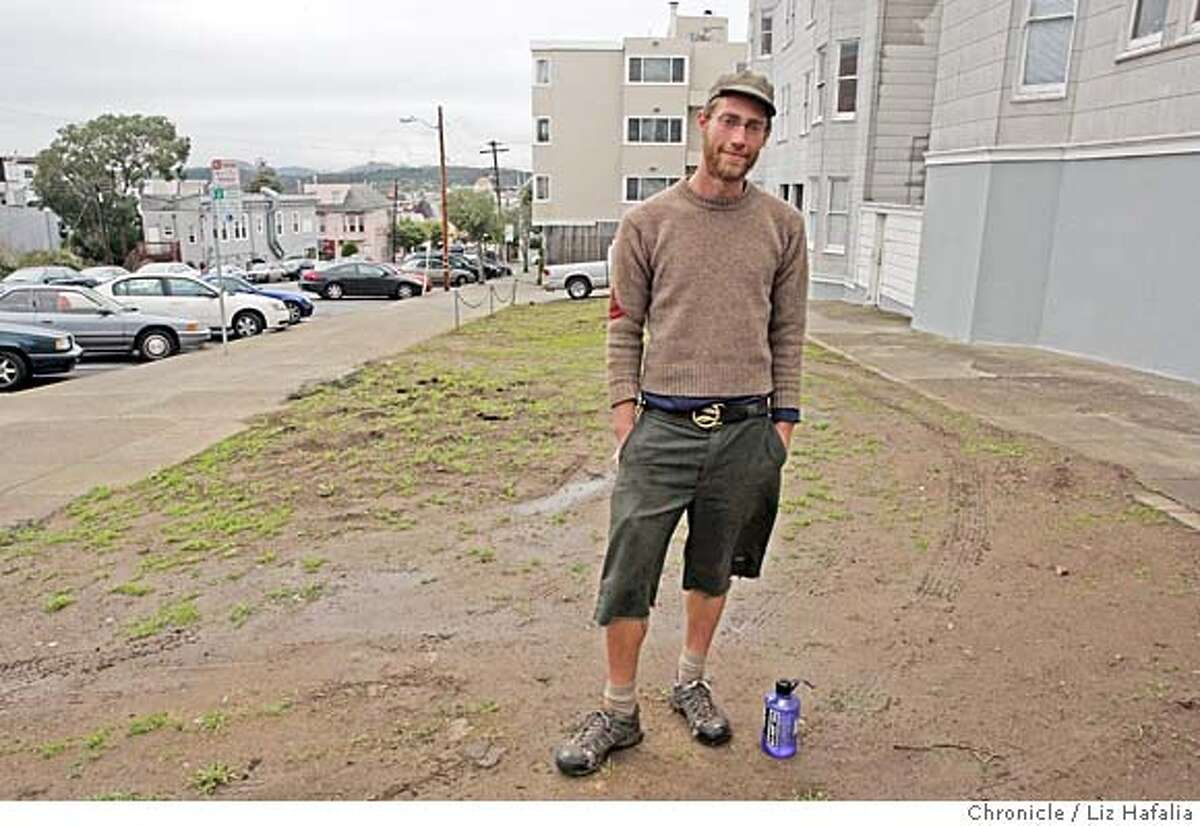 Justin Valon helped spearhead a neighborhood effort to build a garden on a 1300 sq. foot weed-filled parcel on the corner of Stanyan at Fulton streets. When the landowner got wind of his land being used, the garden was plowed, and is now barren again. He is standing on the lot in San Francisco, Calif., on Thursday, 2/21/08. Photo by Liz Hafalia/San Francisco Chronicle Ran on: 03-29-2008 Antonio Roman-Alcala spearheads a community effort to work on the Alemany Farm, which had been deserted for two years.