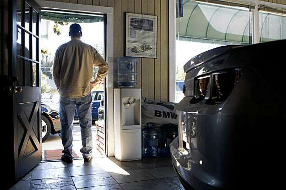Salesperson Bruce Smith, stands in the doorway of the garage at Auto Exchange of Alamo in Alamo, Calif. on Thursday, August 13, 2009. Photo: Lea Suzuki, The Chronicle