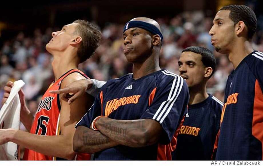 ###Live Caption:From left, Golden State Warriors center Anddris Biedrins, of Latvia, and forwards Al Harrington, Matt Barnes and Brandon Wright look on as time runs out in the fourth quarter of their 119-112 loss to the Denver Nuggets in an NBA basketball game in Denver on Saturday, March 29, 2008.(AP Photo/David Zalubowski)###Caption History:From left, Golden State Warriors center Anddris Biedrins, of Latvia, and forwards Al Harrington, Matt Barnes and Brandon Wright look on as time runs out in the fourth quarter of their 119-112 loss to the Denver Nuggets in an NBA basketball game in Denver on Saturday, March 29, 2008.(AP Photo/David Zalubowski)###Notes:Brandon Wright, Matt Barnes, Al Harrington, Andris Biedrins###Special Instructions:EFE OUT Photo: David Zalubowski