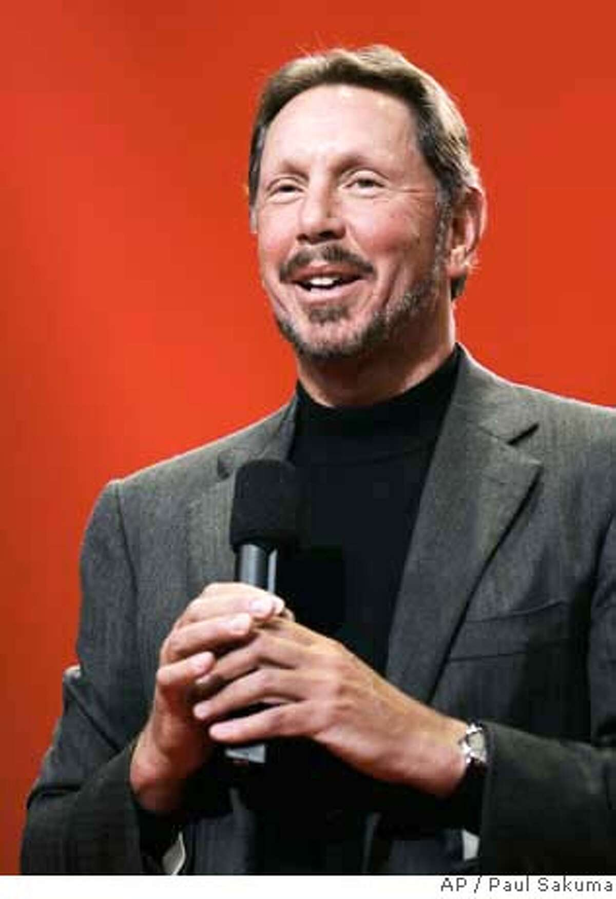###Live Caption:Oracle CEO Larry Ellison is the richest person in the Bay Area and ranks #14 nationally, according to Forbes.###Caption History:**HOLD FOR RELEASE UNTIL 6:01 p.m. EDT THURSDAY, SEPT. 20, 2007. THIS STORY MAY NOT BE PUBLISHED, BROADCAST OR POSTED ONLINE BEFORE 6:01 p.m. EDT THURSDAY** **FILE** Oracle CEO Larry Ellison smiles during his keynote address at Oracle Open World conference in San Francisco, in this Oct. 25, 2006 file photo. Forbes magazine releases its annual rankings of the nation's wealthiest individuals on Thursday, Sept. 20, 2007. (AP Photo/Paul Sakuma, file) Ran on: 09-21-2007 Larry Ellison Rank: 4 City: Woodside Wealth: $26 billion Ran on: 03-06-2008 Ellison###Notes:###Special Instructions:**HOLD FOR RELEASE UNTIL 6:01 P.M. EDT THURSDAY, SEPT. 20, 2007. THIS STORY MAY NOT BE PUBLISHED, BROADCAST OR POSTED ONLINE BEFORE 6:01 P.M. EDT THURSDAY** OCT. 25, 2006 FILE PHOTO