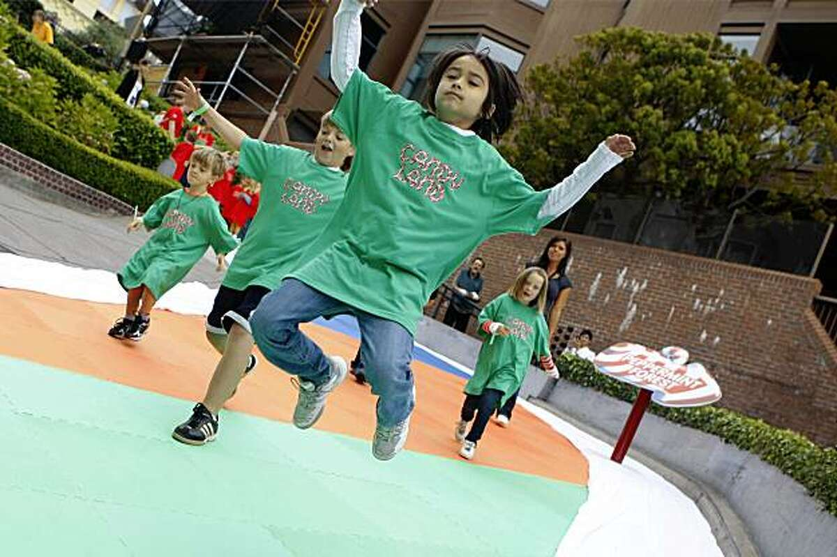 Westley Bartlett, 9 of Los Angeles, and others from the green team which represented the Family House, leaps into the air as he makes his way down Lombard Street between Leavenworth and Hyde Streets during the Candy Land board game in San Francisco, Calif. on Wednesday, August 19, 2009.