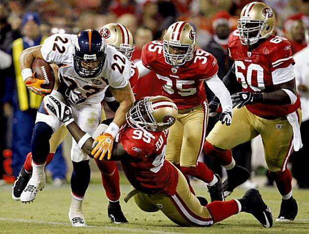 An army of 49ers defenders brings down Denver's Peyton Hillis in the third quarter of the San Francisco 49ers vs. Denver Broncos pre-season football game at Candlestick Park in San Francisco, Calif., on Friday, Aug. 14, 2009. Photo: Paul Chinn, The Chronicle