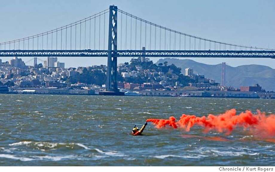 ###Live Caption:Thor Wentz the Chief Aviation Service technician for the Coast Guard in San Francisco, Calif. sets off a smoke canister during a training exercise in the San Francisco Bay on Thursday, March 27, 2008.  Photo By Kurt Rogers / San Francisco Chronicle###Caption History:Thor wentz the Chef Aviation Service technician for the Coast Guard in San Francisco is in the water of San Francisco bay practicing rescue missions. He set off a smoke canister so the Coast guard helicopter can spot he part of the exercises the coast guard was doing in the bay.on Thursday March 27 2008 in San Francisco, Calif  Photo By Kurt Rogers / San Francisco Chronicle###Notes:COASTGUARD###Special Instructions:MANDATORY CREDIT FOR PHOTOG AND SAN FRANCISCO CHRONICLE/NO SALES-MAGS OUT Photo: Kurt Rogers
