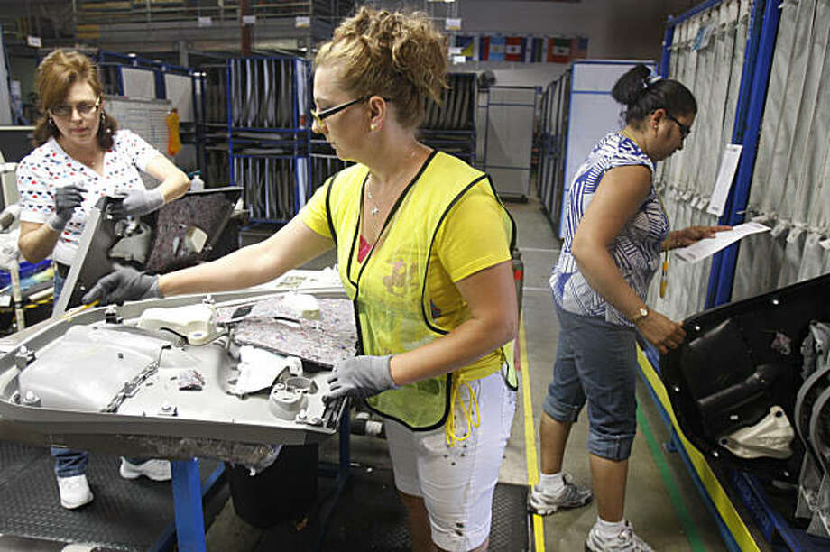 Lucy Angulo, team leader Injex Industries; Korkutovic Hajrija, team leader Injex Industries and Harita Modi, team leader Injex Industries work in the door assembly area at Injex Industries in Hayward, Calif. on Tuesday, August 18, 2009. Photo: Lea Suzuki, The Chronicle