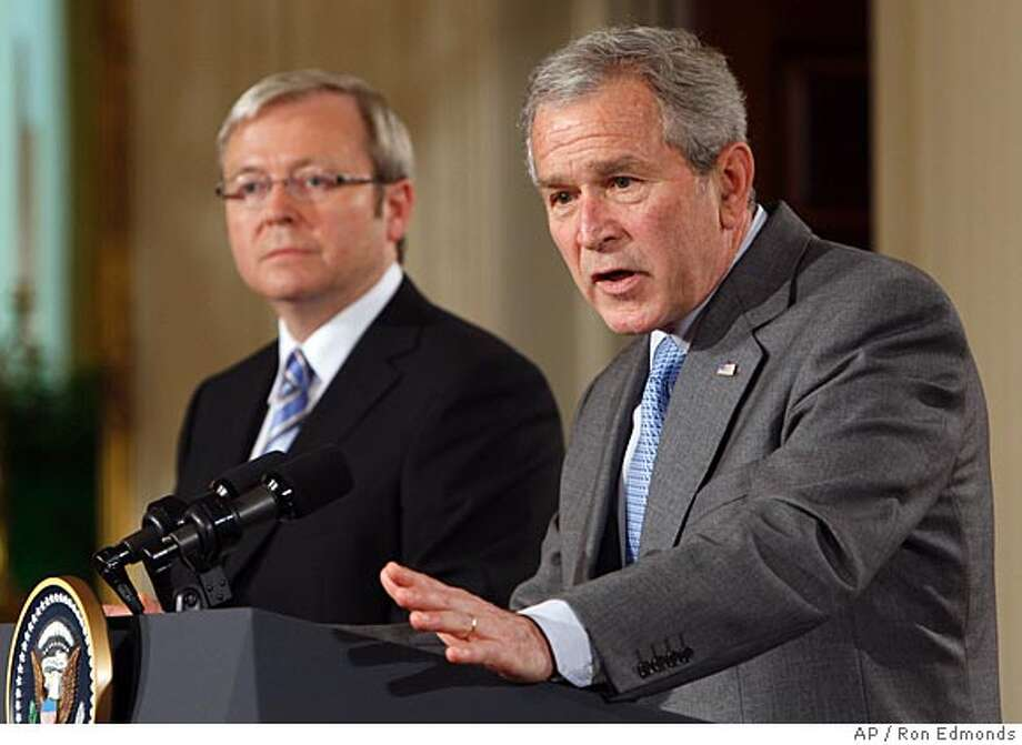 President Bush and Australian Prime Minister Kevin Rudd hold a joint news conference, Friday, March 28, 2008, in the East Room at the White House in Washington. Rudd took over in November on a pledge to pull Australia's 500 combat troops out of Iraq as soon as possible. (AP Photo/Ron Edmonds) Photo: Ron Edmonds
