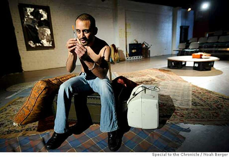 "###Live Caption:Juan De La Rosa, playing the role of Marty Elsworth, addresses a syringe before shooting up during a dress rehearsal for ""Hotshot,"" on Sunday, March 30, 2008, in San Francisco. Photo by Noah Berger / Special to the Chronicle###Caption History:Juan De La Rosa, playing the role of Marty Elsworth, addresses a syringe before shooting up during a dress rehearsal for �Hotshot,� on Sunday, March 30, 2008, in San Francisco. Photo by Noah Berger / Special to the Chronicle###Notes:###Special Instructions: Photo: Noah Berger"