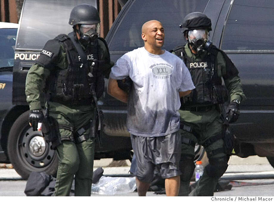 Suspect, James Henderson, 39, who reportedly raped a woman and them barricaded himself inside his home at the Villas Papillion townhouse complex, in Fremont, Calif., of April 1, 2008, is taken into custody after he surrendered. Police fired 7 rounds of tear gas that forced the suspect to came out of his residence. Photo by Michael Macor/ San Francisco Chronicle Photo: Michael Macor