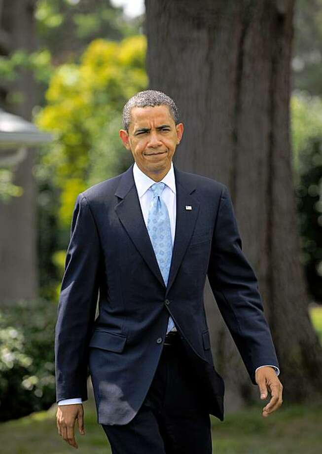 "US President Barack Obama makes his way to speak on the Afghan election on August 21, 2009 on the South Lawn of the White House in Washington. Obama hailed Afghanistan's presidential elections as an ""important step forward"" for the war-torn country. ""This was an important step forward in the Afghan people's efforts to take control of their future, even as violent extremists are trying to stand in their way,"" Obama said.          AFP PHOTO/Mandel NGAN (Photo credit should read MANDEL NGAN/AFP/Getty Images) Photo: Mandel Ngan, AFP/Getty Images"
