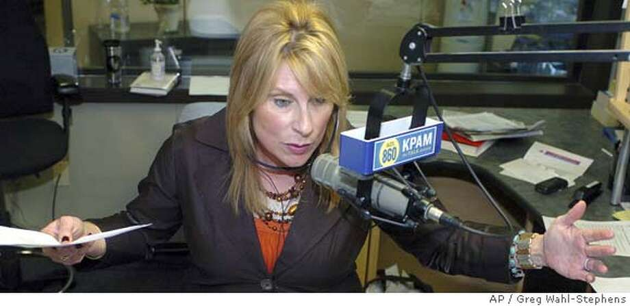 ###Live Caption:Talk Radio Hostess, Victoria Taft, asks her listeners to consider temporarily switching their party affiliation in order to vote for New York Sen. Hillary Clinton in the Oregon Primary, as she broadcasts from her KPAM studio in Milwaukie, Ore., Thursday March 27, 2008. (AP Photo/Greg Wahl-Stephens)###Caption History:Talk Radio Hostess, Victoria Taft, asks her listeners to consider temporarily switching their party affiliation in order to vote for New York Sen. Hillary Clinton in the Oregon Primary, as she broadcasts from her KPAM studio in Milwaukie, Ore., Thursday March 27, 2008. (AP Photo/Greg Wahl-Stephens)###Notes:Victoria Taft###Special Instructions: Photo: Greg Wahl-Stephens