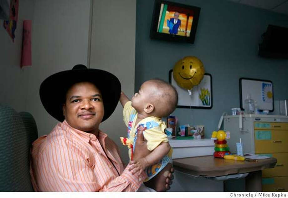 """In the pediatric unit of California Pacific Medical Center, Sanelle Sibanda, a San Francisco movie maker, takes care of his 8-month-old son, Kholwani Sibanda,Tuesday, March 25,2008 in San Francisco, Calif., who was diagnosed with lukemia in January. Sibanda's latest movie """"Generation Now"""" opens Friday at the 4-Star Theater in San Francisco. Photo by / San Francisco Chronicle Photo: Kepka, Mike"""