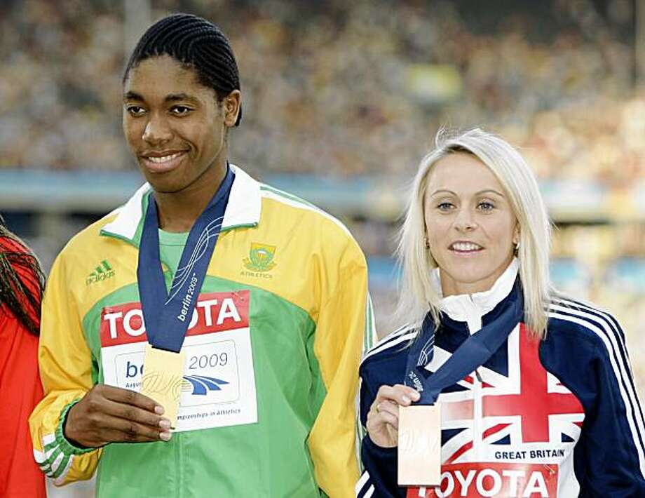 South Africa's gold medal winner Caster Semenya is flanked by Britain's bronze medal winner Jennifer Meadows, right during the ceremony for the Women's 800m final at the World Athletics Championships in Berlin on Thursday, Aug. 20, 2009. (AP Photo/Markus Schreiber) Photo: Markus Schreiber, AP