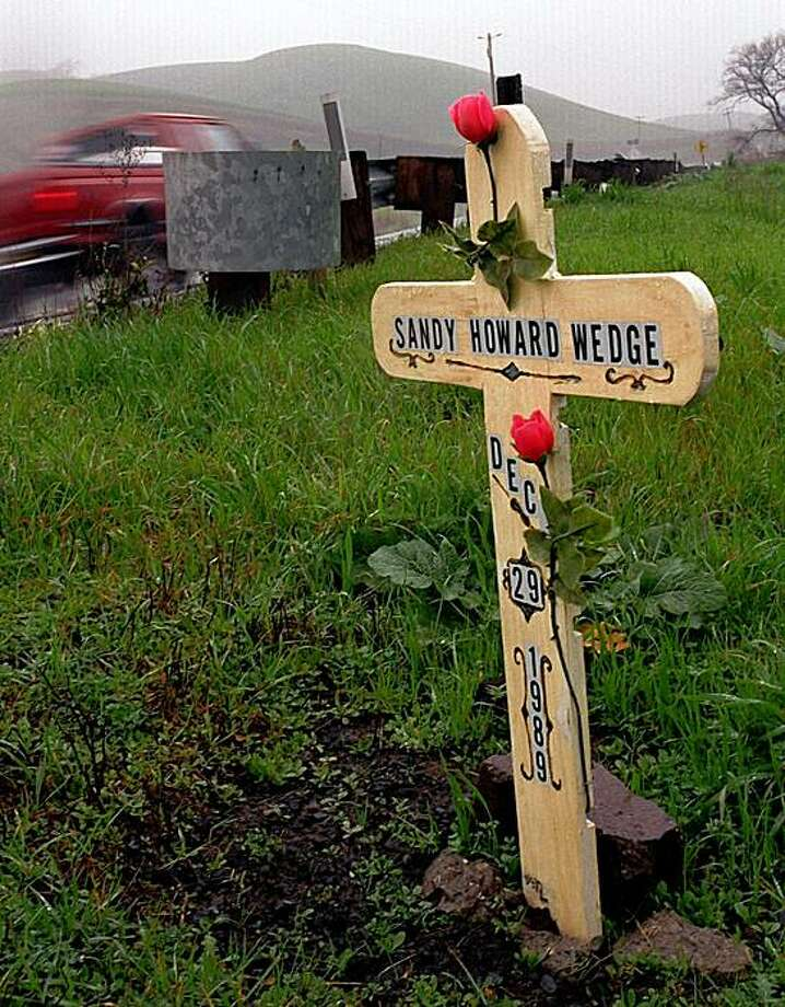 A roadside memorial stands on Highway 4 near the Franklin Golf Course in honor of Sandy Howard Wedge. Photo: Lara Cerri, The Chronicle