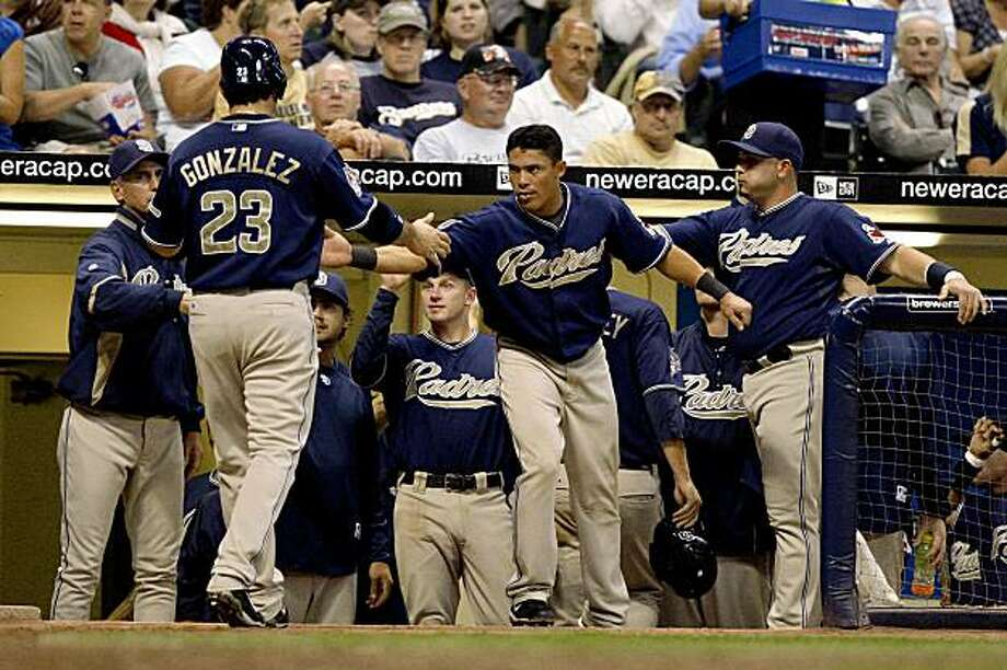 San Diego Padres' Adrian Gonzalez celebrates with teammates after scoring against the Milwaukee Brewers during the sixth inning of a baseball game Tuesday, Aug. 11, 2009, in Milwaukee. (AP Photo/Jim Prisching) Photo: Jim Prisching, AP