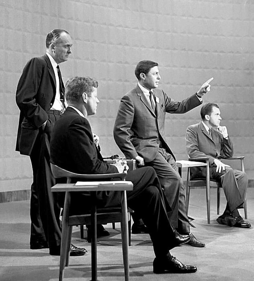 Sen. John F. Kennedy (second from left) CBS' Don Hewitt (second from right) and Vice President Richard M. Nixon (right) take part in the presidential debate on Sept. 25, 1960. Photo: AP
