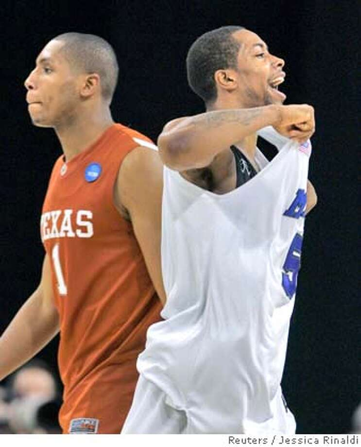 Memphis Tigers' Antonio Anderson (R) celebrates his team's victory as Texas Longhorns' Gary Johnson walks away at their NCAA men's South Regional finals basketball game in Houston, Texas March 30, 2008. REUTERS/Jessica Rinaldi (UNITED STATES) Photo: JESSICA RINALDI