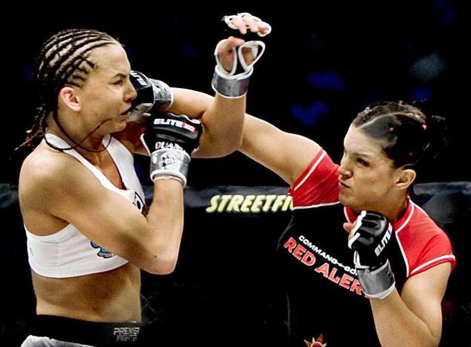 ** ADVANCE FOR WEEKEND EDITIONS, AUG. 8-9 ** Gina Carano delivers a punch during a fight against Kaitlin Young on May 31, 2008, in Newark, N.J. The new face of mixed martial arts, Carano will fight Cristiane Santos in the main event of a Strikeforce show on Aug. 15 at the HP Pavilion in San Jose, Calif. (AP Photo/Esther Lin) ** NO SALES ** Photo: Esther Lin, AP